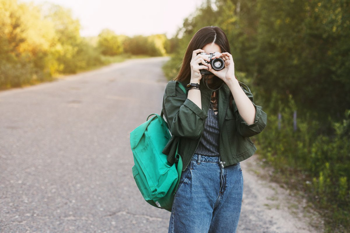 Cute brunette looks at the camera lens. example image 1