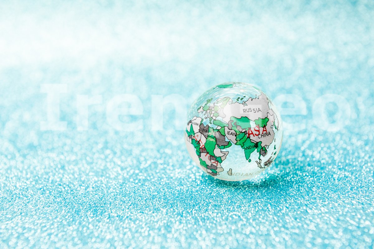 Glass globe ball on a bright blue background example image 1