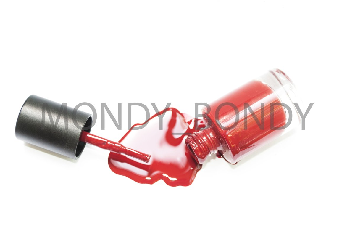 A bottled bottle of red nail polish. Drip varnish example image 1
