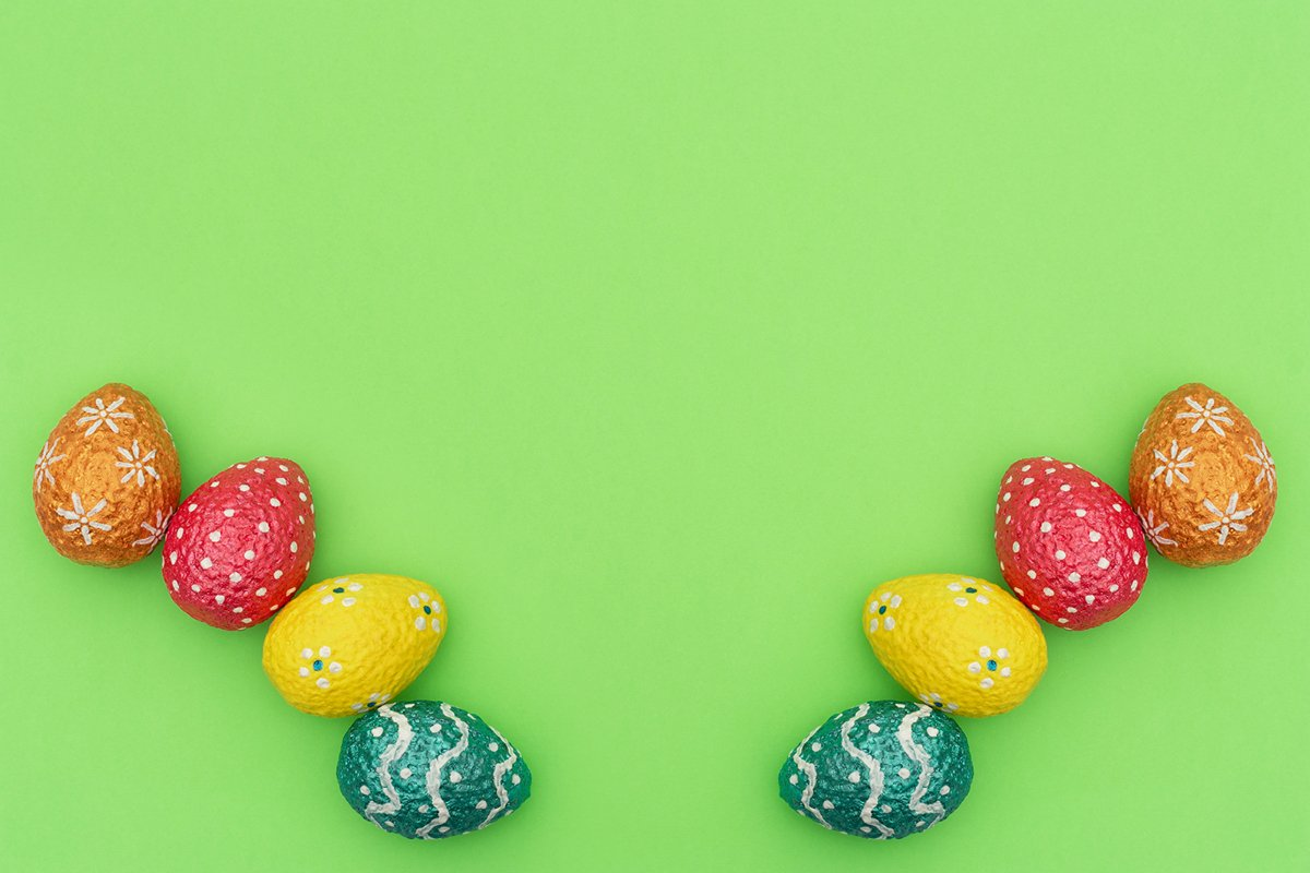 Colorful painted orange, blue, red and yellow Easter eggs example image 1
