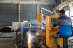 Worker behind a remote control gas welding machine Product Image 1