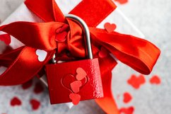 Valentine day holiday card concept with gift boxes on stone Product Image 1
