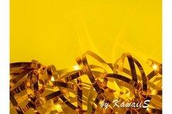 Festive yellow background Golden shiny ribbons texture Product Image 1