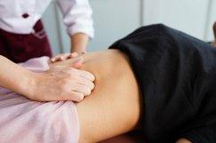 Beautiful young woman having stomach massage Product Image 1