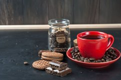 red cup and coffee beans on a black background, Product Image 1