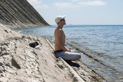The guy is resting sitting on a stone wild beach. 3pcs Product Image 3