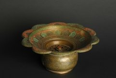 Ancient metal bowl on dark background. Bronze tableware Product Image 1