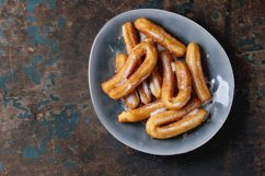 Traditional spanish churros with sugar Product Image 1