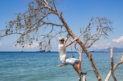 A guy is sitting on a swing made of a fallen tree. 3pcs Product Image 3