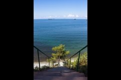 Stairs to the sea on the rocks leads to the beach. 3 pcs Product Image 2