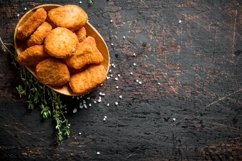 20 Photos Chicken nuggets and strips with spices. Background Product Image 6