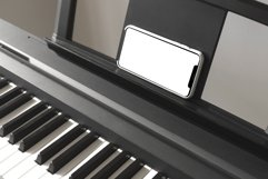 Isolated smartphone screen on piano Product Image 2