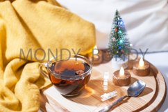 Christmas / New Year composition. A transparent cup of tea Product Image 1
