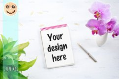 Notepad mockup with green plant and pink orchid. Product Image 1