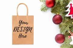 Kraft shopping bag mockup on Christmas styled background Product Image 1