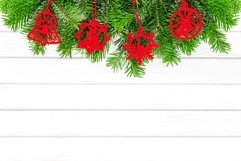 Red Christmas ornaments white wood background Product Image 1