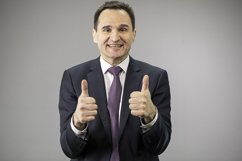 Portrait confident businessman on isolated gray background Product Image 1