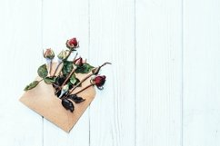 Rose buds on the background of old boards Product Image 2