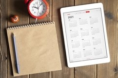 tablet with calendar for 2021, clock, notebook, copy space Product Image 1