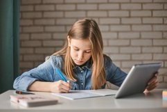 Girl doing homework on tablet. Distance learning Product Image 1