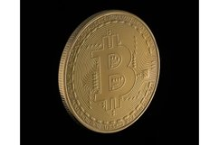 Gold bitcoin on a black background. Electronic money Product Image 1