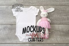 MOCK-UP - White one-piece baby onesie with popular bunny Product Image 1