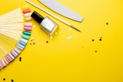 Top view of manicure equipment on yellow background Product Image 1