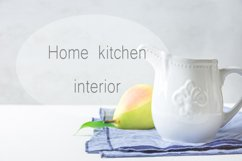 Vintage pitcher pear on kitchen table Product Image 1