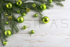 Christmas background decorated with green bauble hanging. Product Image 1