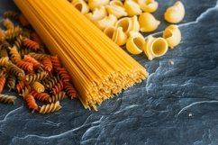 Different types of pasta on a stone Product Image 2