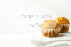 Home baked pumpkin carrot muffins on kitchen table Product Image 1