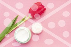 Spring skin care. Tulip and jar of cream on a pink backgroun Product Image 1