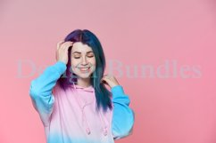 Girl listening to music on headphones on a pink background Product Image 2