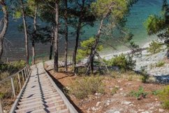 Stairs to the sea on the rocks leads to the beach. 3 pcs Product Image 3