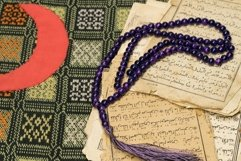 Muslim prayer beads with ancient pages from the Koran Product Image 1