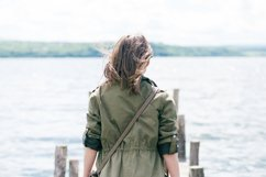 Hipster girl on a wood pier Product Image 1