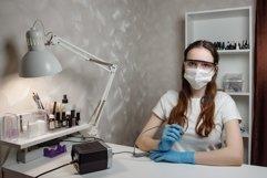 Beautiful girl manicurist in beauty salon Product Image 1