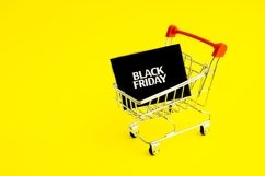 Shopping cart, and black Friday on yellow background Product Image 1