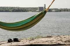 The hammock hangs near the river. Journeys. Product Image 1