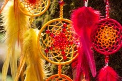 Dreamcatcher made of feathers leather beads and ropes Product Image 1