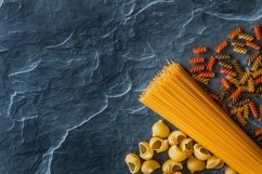 Different types of pasta on a stone Product Image 4
