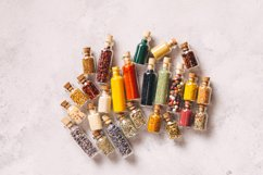 Assorted ground spices in vintage bottles Product Image 1