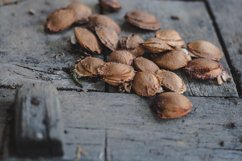Apricot kernels on wooden background Product Image 1