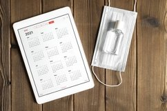tablet with calendar for 2021. covid-19 protection concept Product Image 1