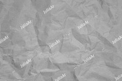 Crumpled recycled paper. Black and white background Product Image 1