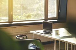 Modern workplace with laptop near the window. Product Image 1