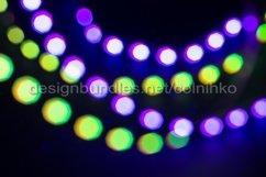 Purple green neon blurry bokeh lights Product Image 1