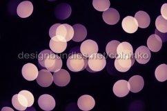 Violet bokeh lights glow on black Product Image 1