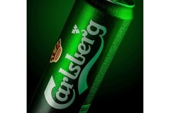 Can of beer Carlsberg with drops of water in a green Product Image 1