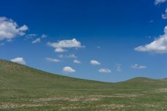 Natural landscape with hills against blue sky with white clo Product Image 1